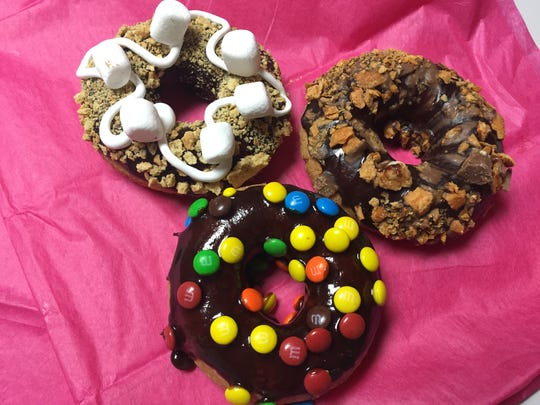 Doughnuts include s'mores, chocolate glaze and Butterfinger, chocolate glaze and M&Ms.