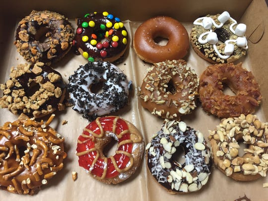 A dozen of Artful Doughnut confections features a mix and match of choices.