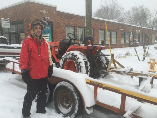 Bryan Marshall prepares to plow the Mardis Building parking lot on Haywood Road Friday. Between 6 and 8 inches of snow covered the ground at the time.