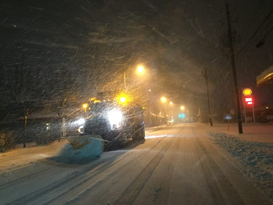 A city of Asheville snowplow churned down Haywood Road around 6 a.m. on Friday, removing 6 to 8 inches of snow from the street.