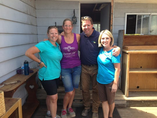 """Matt Paxton, extreme cleaning specialist for the A&E show """"Hoarders,"""" poses for a photo with professional organizers Megan Spears, from left, Kristin Bertilson and Julie Starr Hook of Salem during a break in filming an episode of """"Hoarders."""""""