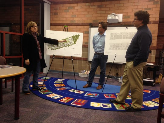 Tammie Cleek, left, tells developers during a meeting