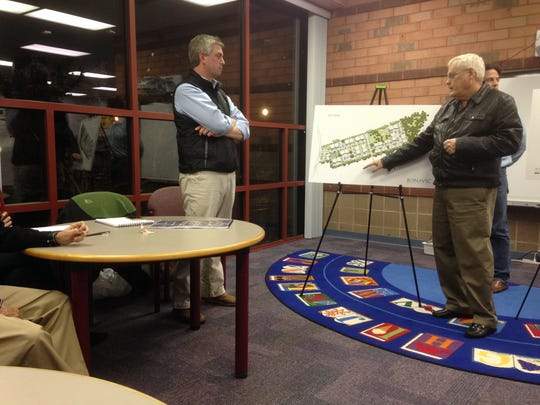 Leslie Smith, right, tells developer Charles Haskett, left, about concerns that 269 proposed apartments will cause noise and other problems to the neighboring Brookwood subdivision on Manson Pike in the Blackman community on the west side of Murfreesboro.