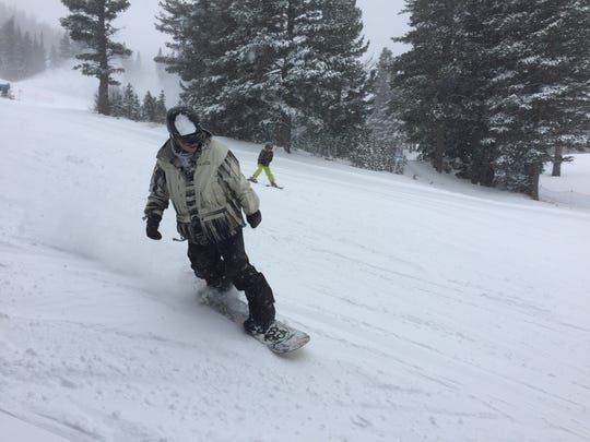 A snowboarder at Mt. Rose Ski Tahoe in Reno enjoys a powder day.