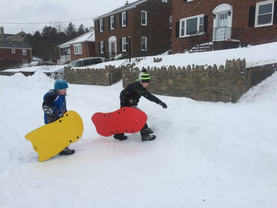 Connor Turner, 10, and Nicholas Turner, 6, get ready to sled on Saturday in Wilmington.