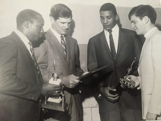 Lakewood's Jose Decausey (second from right) accepts an award for being the school's top basketball player from New York Yankees pitcher Ralph Terry (third from right) in 1968.