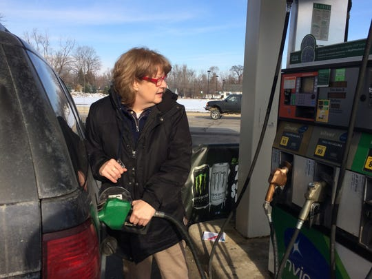 Iosco Township resident Donna DeRouchia pumps in a little more than five gallons at the BP service station in Fowlerville.