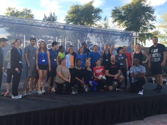 Guests at the Clinton Foundation's Health Matters Summit pose with fitness expert Sydney Benner after a morning workout.