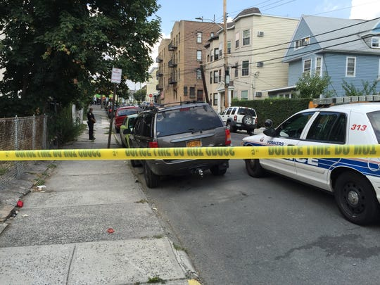 Yonkers police investigate a shooting in August 2015.