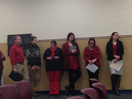 Teachers and residents waited to speak before the district's Board of Education during its meeting on Monday. The district's 270 teachers have been in contract negotiations with the district's administration since March of last year.
