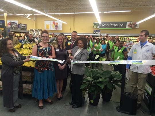 Simpsonville Mayor Janice Curtis cuts the ribbon during the grand opening of the new Walmart Neighborhood Market on West Georgia Road in Simpsonville.