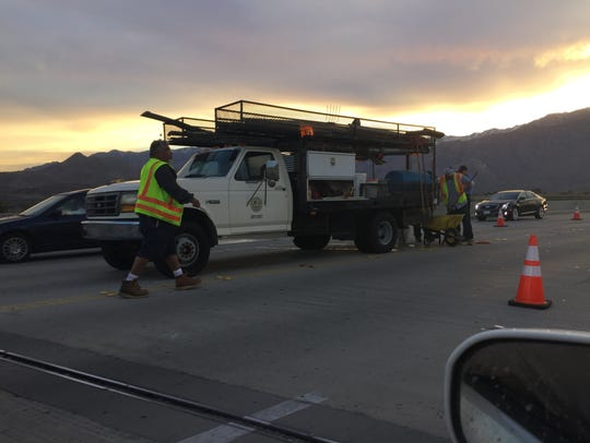 A crew works on a road in Palm Springs.
