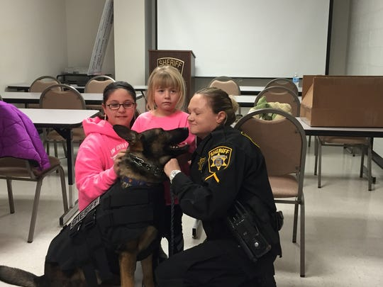 From left, Dylan Joseph's sister, Taylor Joseph; his cousin, Kyley Ward; and Deputy 1st Class Bobbijo Lewis are shown with K-9 Rookie posing for a photo at the Wicomico County Sheriff's Office on Tuesday, Jan. 26, 2016.