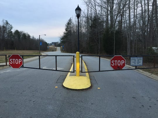 The back gate of Heritage Park is now closed.