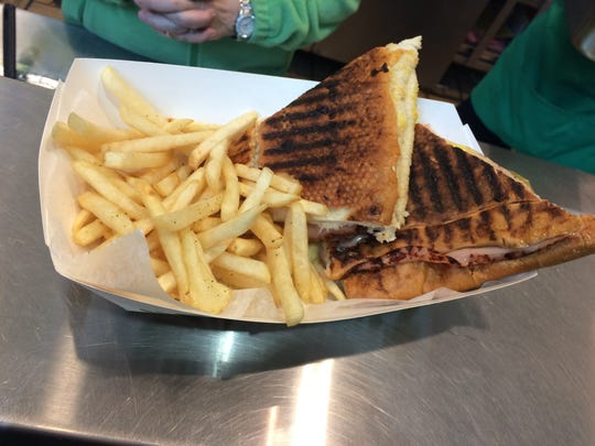 A pressed Cuban sandwich, with off-menu fries, from Havana Cafe in Coral Ridge Mall on Jan. 28, 2016.