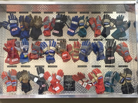 Signed gloves adorn the wall of Bobby Rahal's man cave.