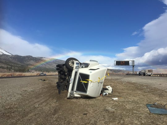 A truck lies on its side Friday along U.S. 395 in Washoe