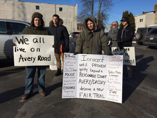 Protesters hold signs at a protest for Steven Avery