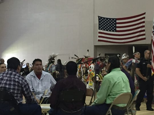 Drummers sit in the center of the Alabama-Coushatta