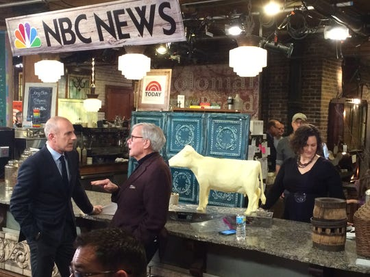 "Matt Lauer chats with Tom Brokaw while Butter Cow sculptor Sarah Pratt puts the finishing touches on her 40-pound Jersey during the ""Today"" show at West End Architectural Salvage."