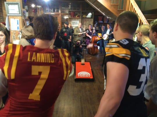"Iowa State quarterback Joel Lanning and University of Iowa linebacker Travis Perry led a Cy-Hawk cornhole showdown during the ""Today"" show at West End Architectural Salvage."