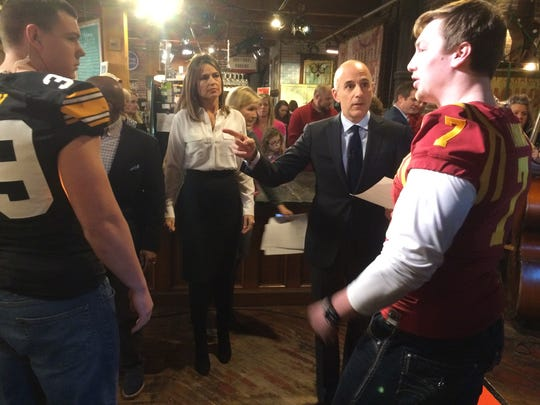 "Iowa State quarterback Joel Lanning and University of Iowa linebacker Travis Perry explained the finer points of cornhole to Savannah Guthrie and Matt Lauer during the ""Today"" show at West End Architectural Salvage."