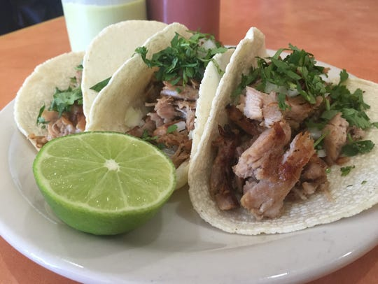 Pork is roasted on site for these tacos.