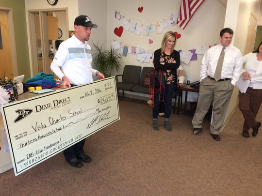A small check passing ceremony took place Tuesday at Vista School from Dixie Direct.