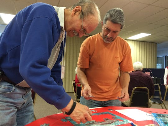 Ned Anderson and Mark Honold, who used to teach math and coach basketball together, put a puzzle together at the Memory Cafe.