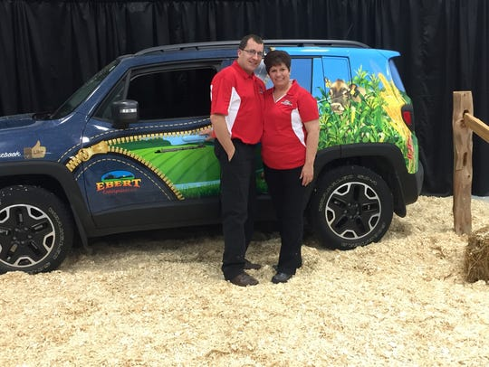 "Randy and Renee Ebert with their car, ""Ag ProMotor,"