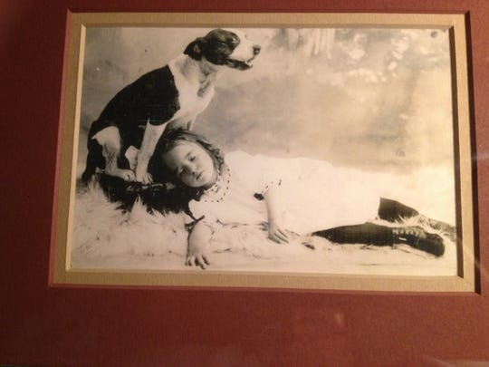 A child with her beloved dog, a style of photography
