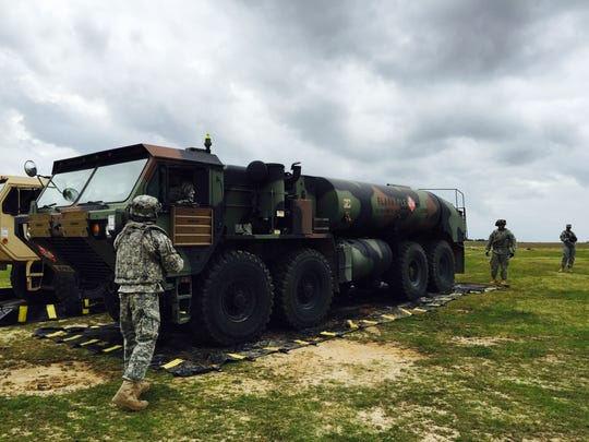 Soldiers with 2nd Battalion, 501st Aviation Regiment set up a FARP, a forward arming and refueling point.