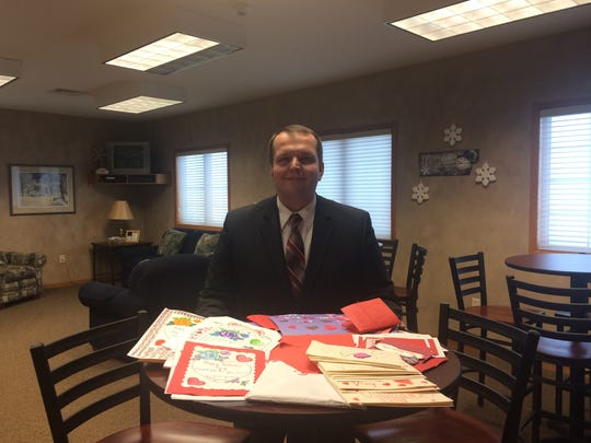 Justin Herman, Herman -Taylor Funeral Home, displays some of the Valentine's Day cards he's collected for veterans at King.