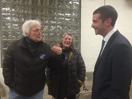 Ben Lindy, right, talks with supporters after the Hamilton