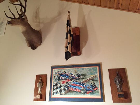 Two Indy 500-winning plaques hang on the wall in Gordon Johncock's home.