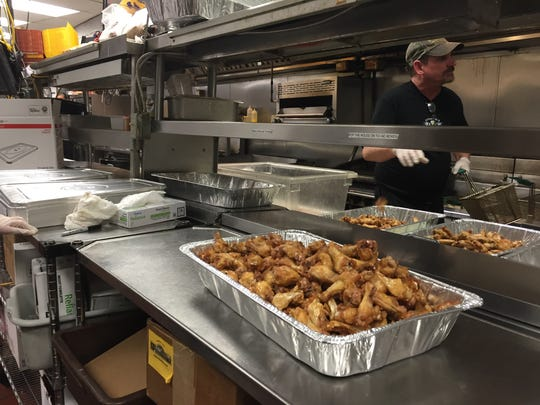 PJ Wheilhan's cook Terry Bailey prepares wings for Wing Bowl 24