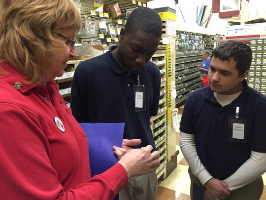 Ginny Williams, Gil's Ace Hardware owner and Rotary member, talks with job-shadow students Naquis Green, center, and Michael McDaniel.