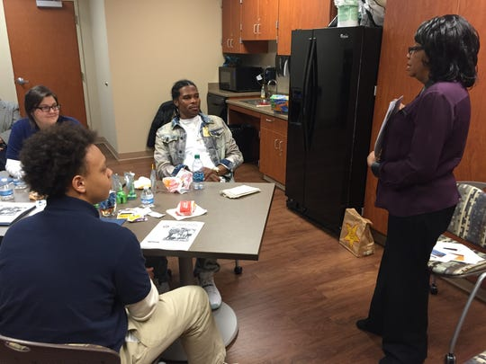 Motlow College's Moneda Grimes talks with Smyrna West students Julie Warnack, far left, and Malik King as former Smyrna West students and current Motlow student Joshua White listens.