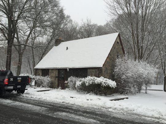 The former gas station on the northbound side of the Bronx River Parkway during a snowstorm Feb 25, 2015. The stations have been mostly unused for decades.