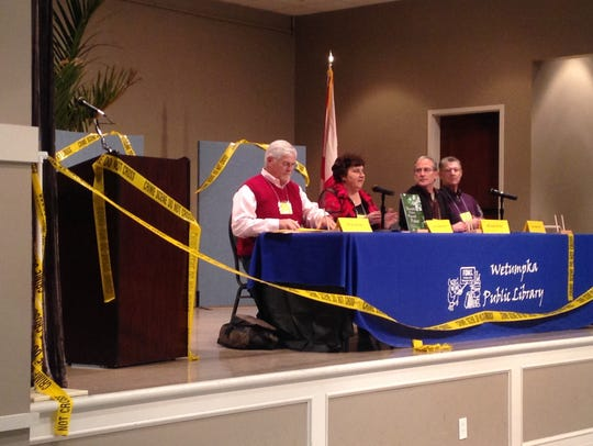 Authors talk on a panel at the annual Murder on the