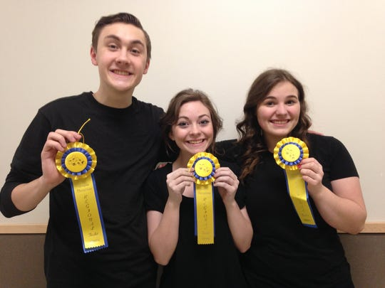 Luke Disney, Emily Johnson, center, and Molly Bucher pose with their regional finalist ribbons in duo and solo acting at the Oregon Thespians' Regional Acting Competition in Independence on Feb. 6.