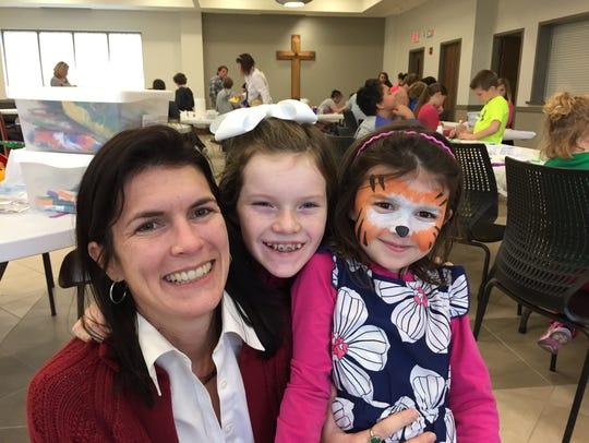 Trisha Ambrose, left, and her daughters, Clara Ambrose
