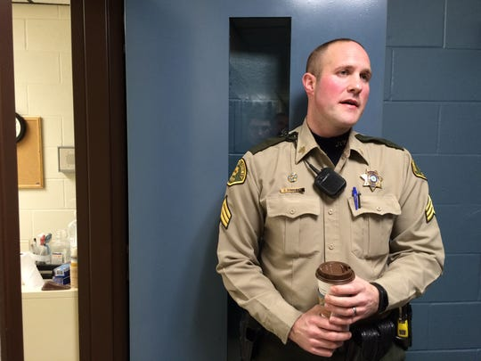 Johnson County Sheriff's Sgt. Jeff Gingerich leads