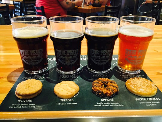 A flight of beers with their complimentary Girl Scout