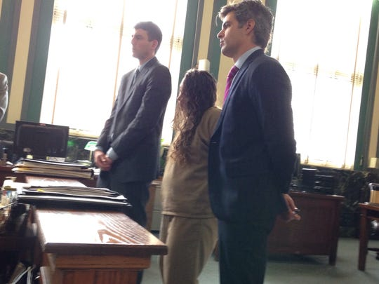 Kathy Huff stands in Hamilton County Common Pleas Court on Wednesday, flanked by attorneys Nicholas Graman (left) and Charlie Rittgers.