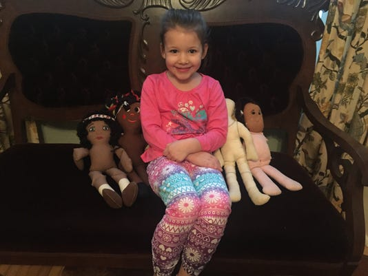 635907146251843799-Lura-s-daughter-parker-with-dolls.JPG