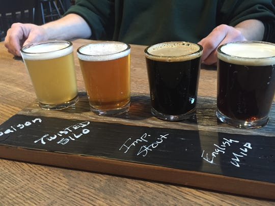 A flight of Reclaimed Rails' beers goes for $5.