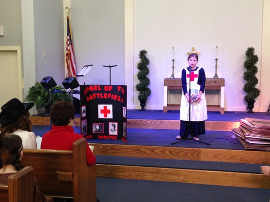 Grace Christian School fifth-grader Audrey Spears gives her Biography Day presentation Thursday as Clara Barton, founder of the American Red Cross.