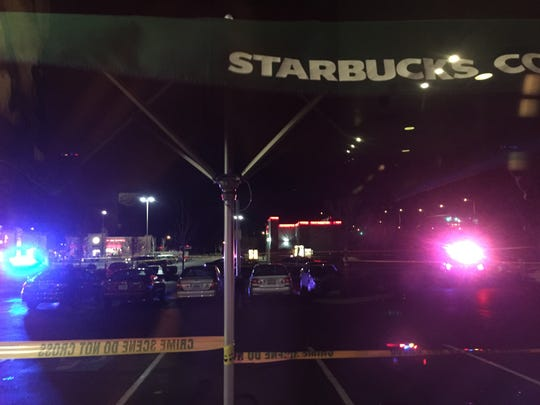 Police investigating a shooting in a parking lot at Keizer Station.