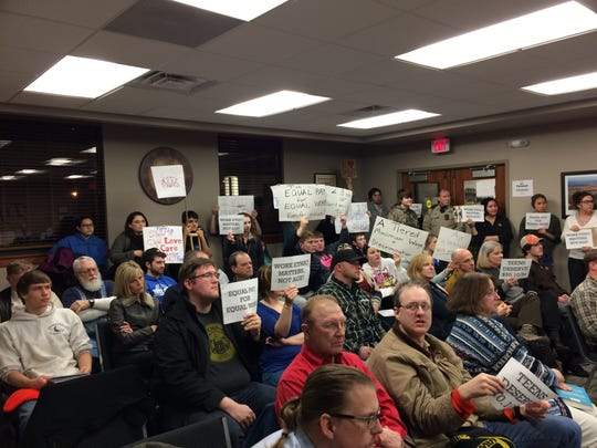 About 40 people attended the Tiffin City Council's meeting on Tuesday night. Many came to oppose a tiered minimum wage ordinance that would allow teenagers to be paid less than adults.